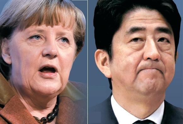 メルケル独首相(左)と安倍日本首相。