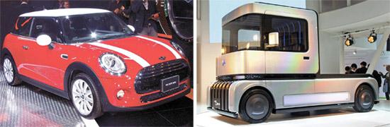21日、東京モーターショーの主人公は小型車。BMWミニはミニクーパー第3世代新型(左)を出した。ダイハツの燃料電池小型トラックFC凸デッキ(右)も注目を集めた。