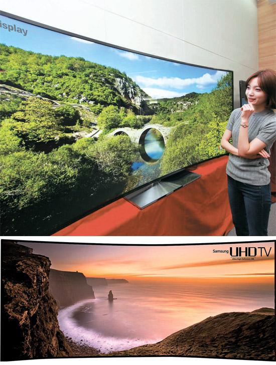 LG電子とサムスン電子は19日、105インチの曲面超高画質テレビを公開した。両社は来月7日に米国で開かれる「消費者家電展示会(コンシューマー・エレクトロニクス・ショー)2014」で公式発表する予定だ。(写真=LG電子・サムスン電子)