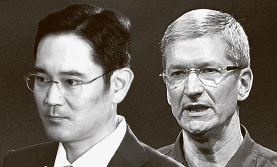 サムスン電子の李在鎔副会長(左)とアップルのティム・クック最高経営責任者