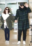 27日午前、新婚旅行を終えて帰国した女優キム・テヒ(左)と歌手Rain。