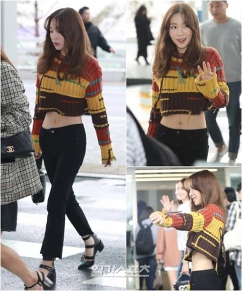5日、仁川国際空港に登場した少女時代のテヨン。