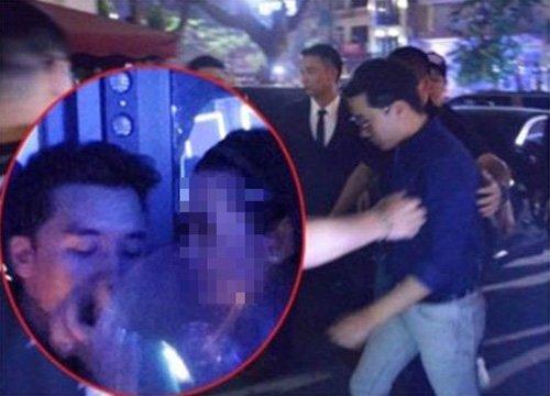 ベトナムのポータルサイトが2017年2月に報じた「V.Iのハッピーバルーン吸入疑惑」写真。V.Iと推定される男性が女性に手伝われながら透明な袋の中身を吸入している。YG側は「巧妙に撮られた写真」だと反論した。(写真=バオモイドットコムキャプチャー)