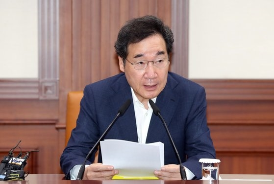 李洛淵国務首相。ウ・サンジョ記者