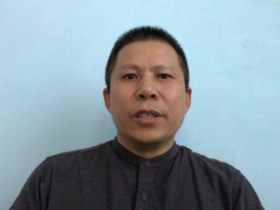 習近平政府を批判する文書を書いて公安に逮捕された許志永氏[BBCユーチューブ キャプチャー]
